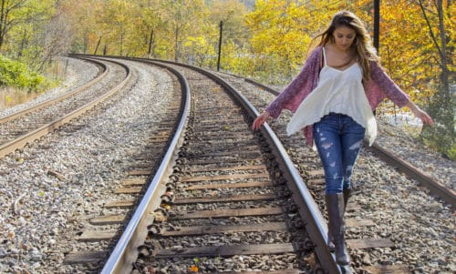 Girl Walking on Railroad Tracks Senior Picture